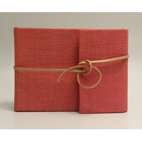 Photo albums covered in red cloth with leather lanyard closure.