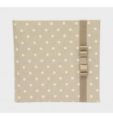 Photo album in fabric printed with polka dots and ornament on the cover in beige fabric