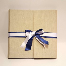 Photo album covered in canvas natural linen, double blue and white satin ribbon.