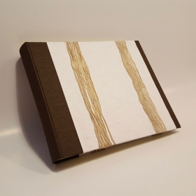 Photo album made with canapetta brown canvas and paper mulberry ropes palm as a decoration on the cover