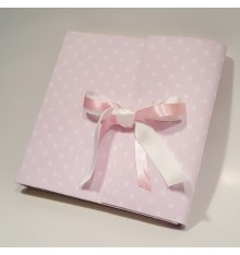 Photo album in pink fabric printed with polka dots and pink white satin ribbon.