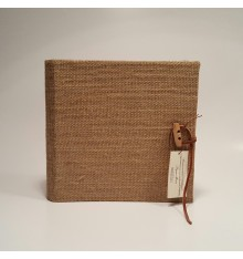 Photo album covered in jute and closing wooden.