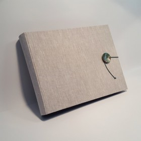 Photo album in linen cloth with decorated hand-crafted button.