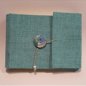 Photo album 20x15 covered with emerald green jute