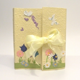 Photo album coated yellow paper mulberry and decored decoupage flowers and butterflies