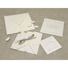 Wddings card paper leaf rubber, organza and satin ribbons. Interior silk paper.