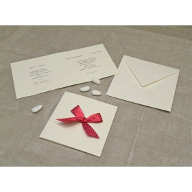 Wedding card in mulberry paper with red satin bow with polka dots