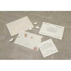 Wedding card in high quality paper with rice and red petals