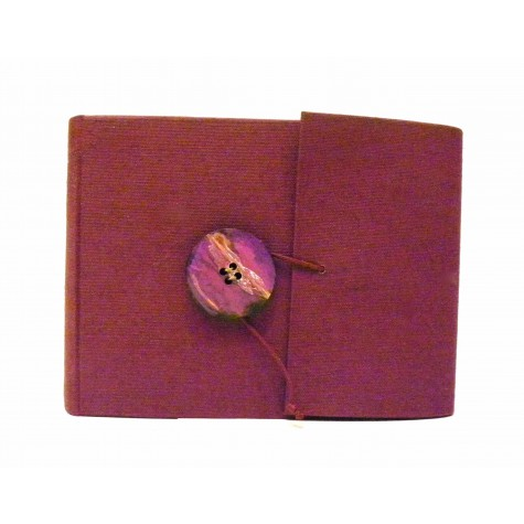 Photo album covered in burgundy cloth with wooden button effect artistic ceramics and drawstring closure