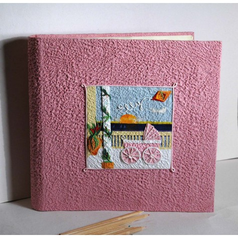 Album for child covered in pink paper and decorated Moonrock collage pink wheelchair and kite