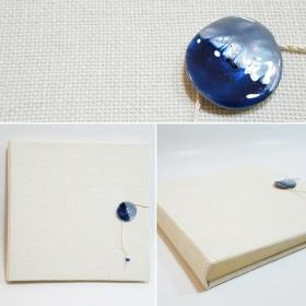 Album fotografico Murano rivestito in Juta bianca e bottone effetto vetro