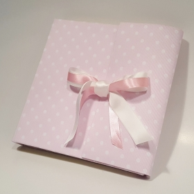 Photo album blue fabric printed with polka dots and ivory satin ribbon.