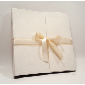 Photo album covered in white linen and double staple of ivory satin and organza