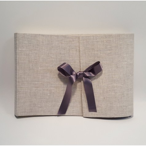 Photo album with flap made of canvas with satin bow