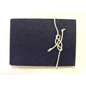 Photo album covered with fabric blue jeans and decorative cover with rope sailor