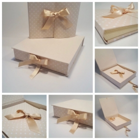 Photo album beige fabric printed with polka dots and ivory satin ribbon.
