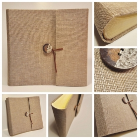 Photo album coated with cheesemaker natural canvas, button ceramic effect and closure in leather