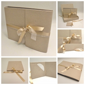 Traditional photo album covered in natural linen with double satin ribbon and organza