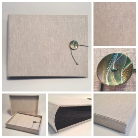 Photo album with decorated hand-crafted button