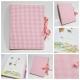 Album tessuto rosa a quadretti e nastro di raso