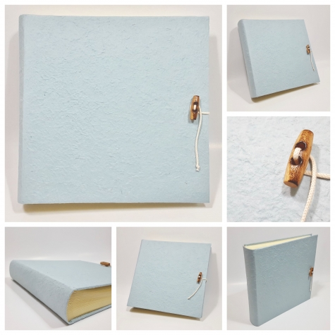 Photo album with flap made whit paper mulberry lilac with button in ordinated and lanyard with beads