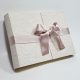 Quilted striped fabric and double bow in ivory satin