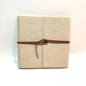 Photo album covered with natural linen and eco-leather closure
