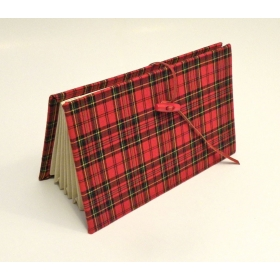 Document holder with compartments lined with tartan fabric closure leather lace and red frogging closed.