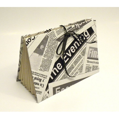 Documents compartments covered in fabric printed newspaper with closure leather lace