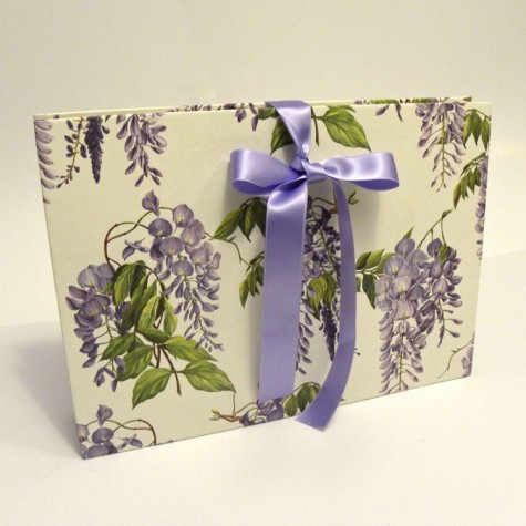 Document holder made of paper with printed satin bow and wisteria wisteria