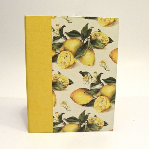 Cookbook made with paper printed with lemons and yellow canvas back