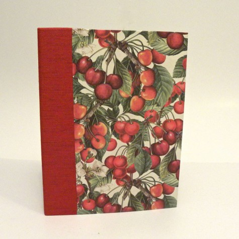 Cookbook made with paper printed with cherries and red canvas back
