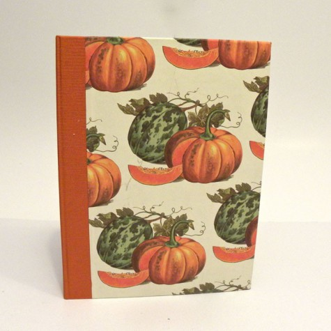 Cookbook made with paper prints with pumpkins and orange canvas back