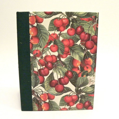 Cookbook made with paper printed with cherries and green canvas back