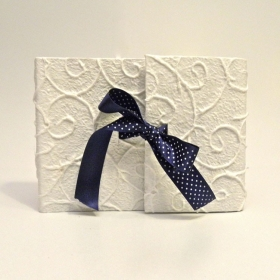 Photo album with flap covered with paper mulberry spirals with satin bow polka dot