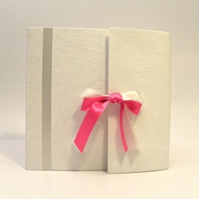 Photo album with flap made whit white mulberry paper, insert and satin bow white and fuxia