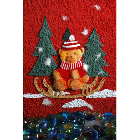 Photo album covered in red Moonrock paper, collage decorate with Teddy bear Santa Claus.