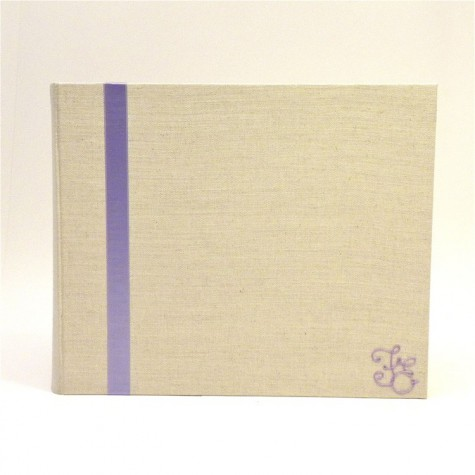 Photo album covered in natural linen canvas with lilac satin insert